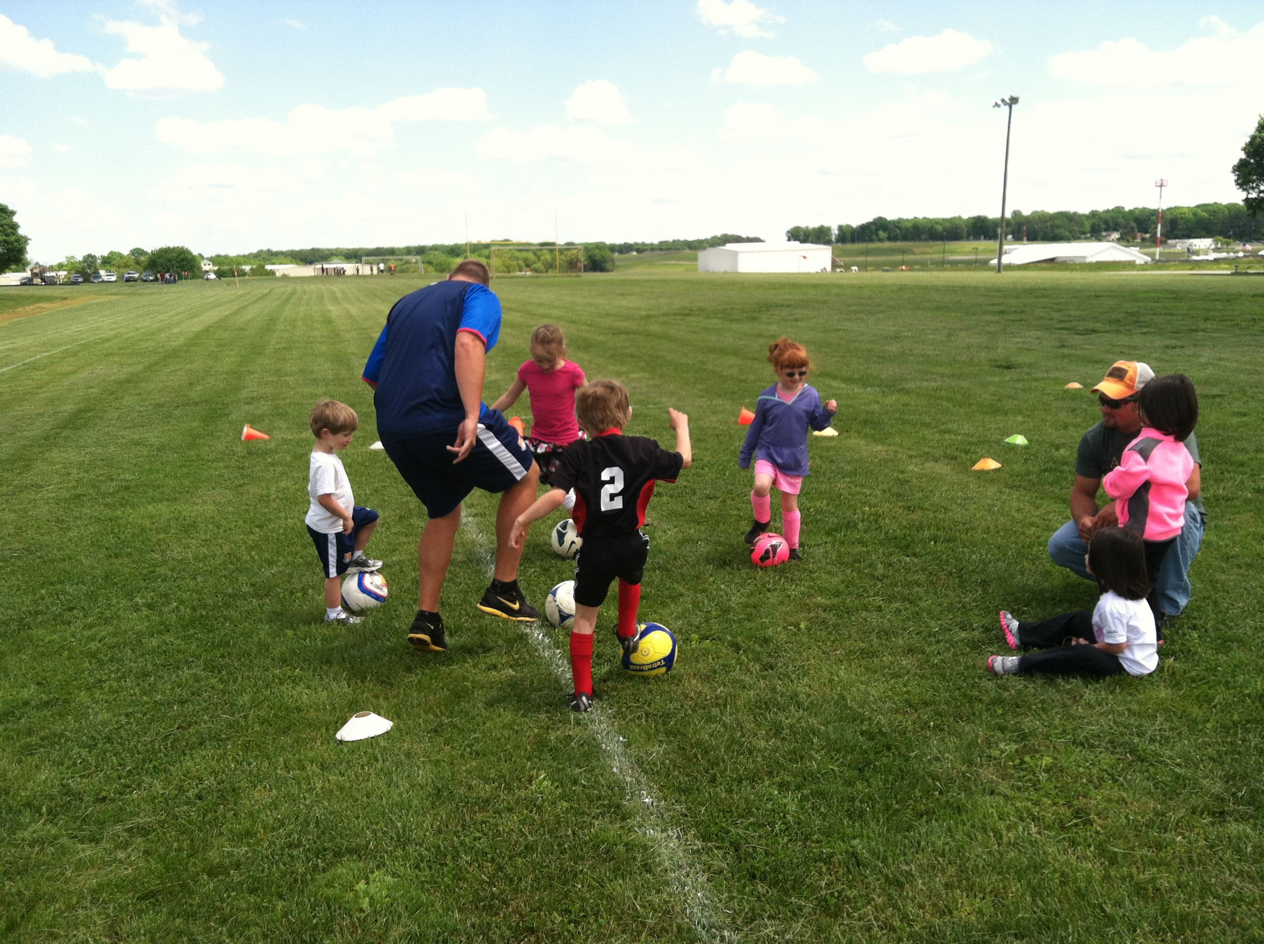 Participants practice at an OCPR Challenger Sports Soccer program.